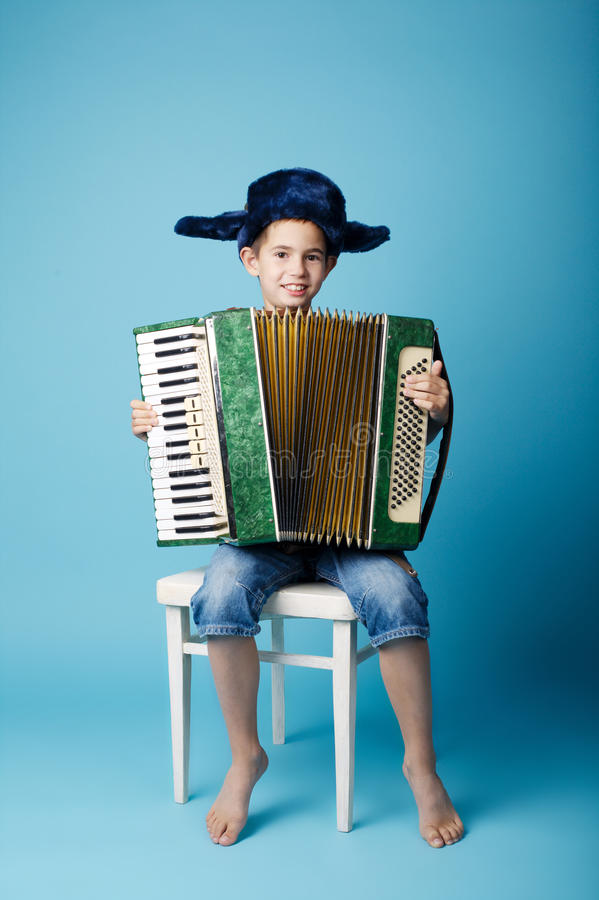 Download Little Accordion Player On Blue Background Stock Image - Image of keyboard, music: 57564101