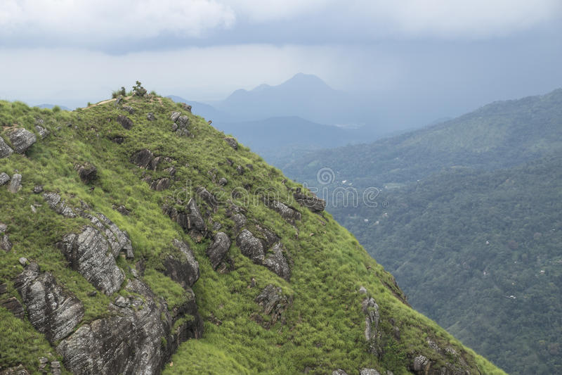 Little Adams peak shortly before rainfall, Ella, Sri Lanka. Green mountain with view on foggy mountains with raincloud, Sri Lanka stock images