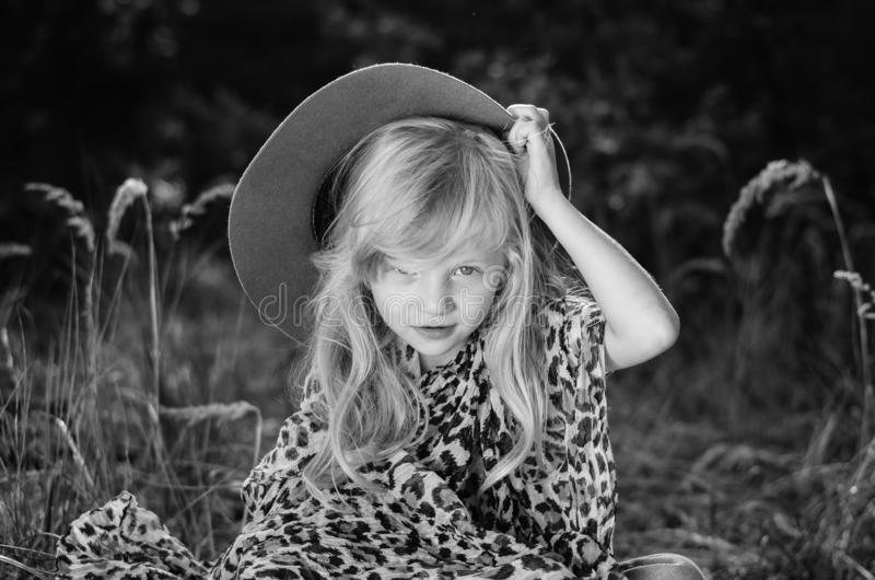 Little child  with long blond hair and hat royalty free stock photo