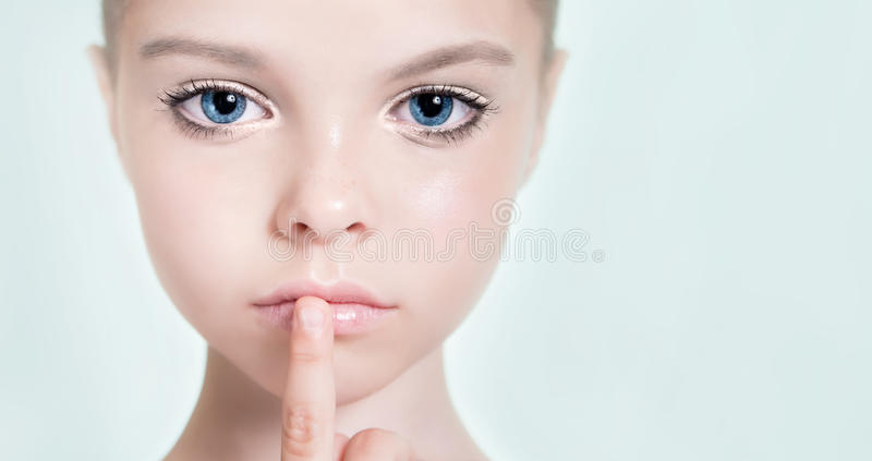 Little adorable fashion eight-year model girl with with a profe. Ssional makeup. Beauty make up. Copyspace royalty free stock photos