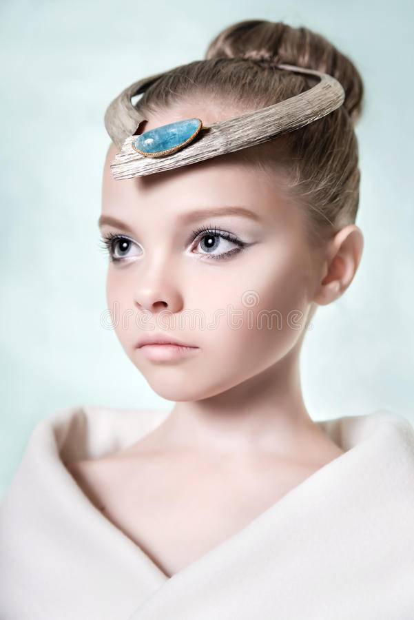 Little adorable fashion eight-year model girl with with a profe. Ssional makeup and jewelry. Beauty make up stock image