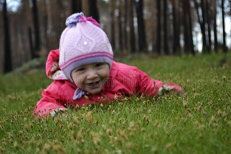 Little adorable girl lying on grass royalty free stock images