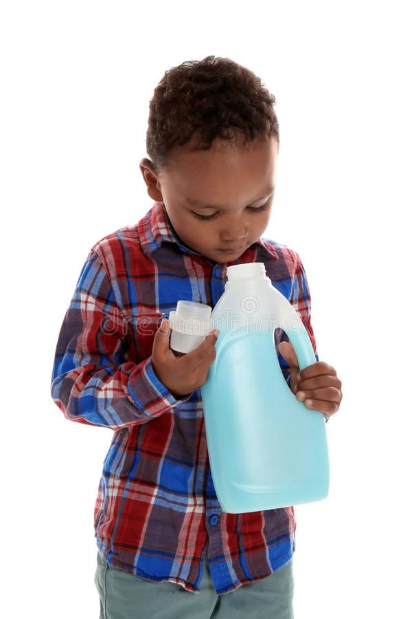 Little African-American boy playing with detergent on white background stock photo