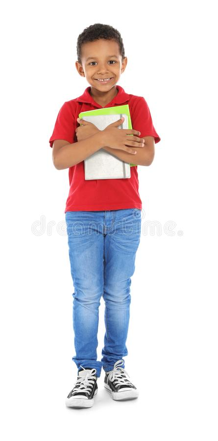 Little African-American child with school supplies. On white background stock images