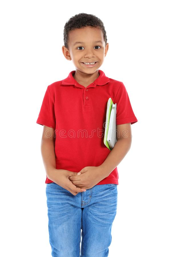 Little African-American child with school supplies. On white background royalty free stock photography