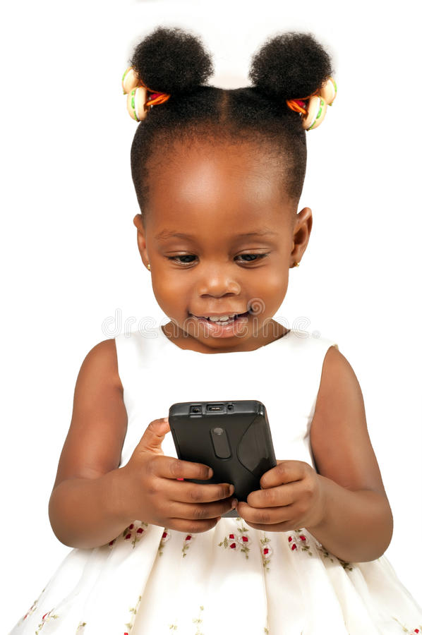 Little girl smiling at a mobile phone royalty free stock photos