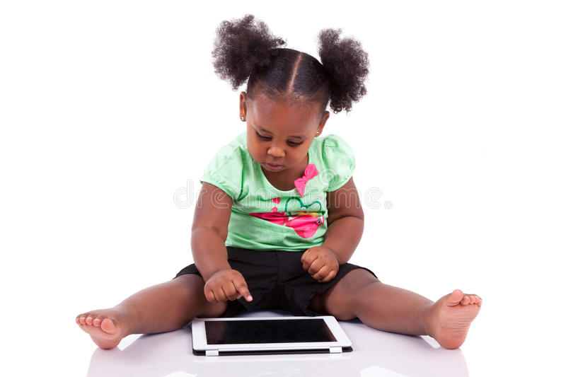 Little african american girl using a tablet pc royalty free stock image