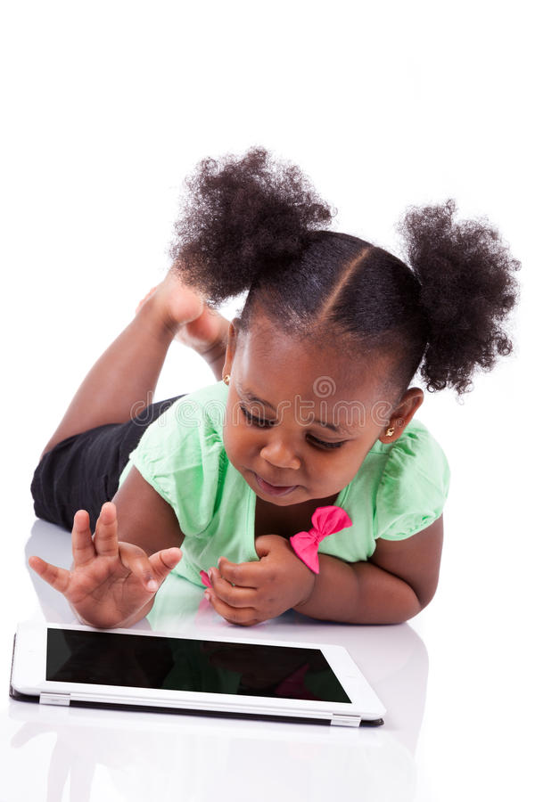 Download Little African American Girl Using A Tablet Pc Stock Image - Image: 28324873