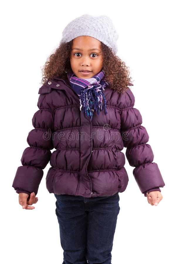 Little african asian girl wearing winter clothes royalty free stock image