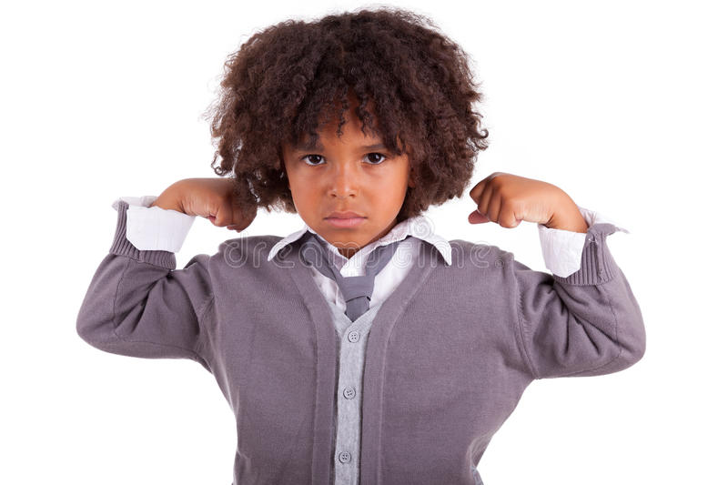Little african boy showing his muscles. Portrait of a little african boy showing his muscles ,isolated on white background stock photo