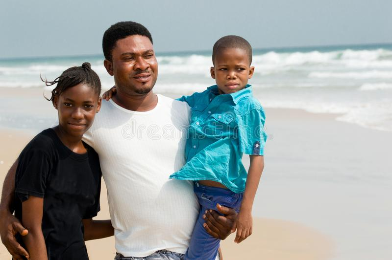 Little african family at the beach stock images