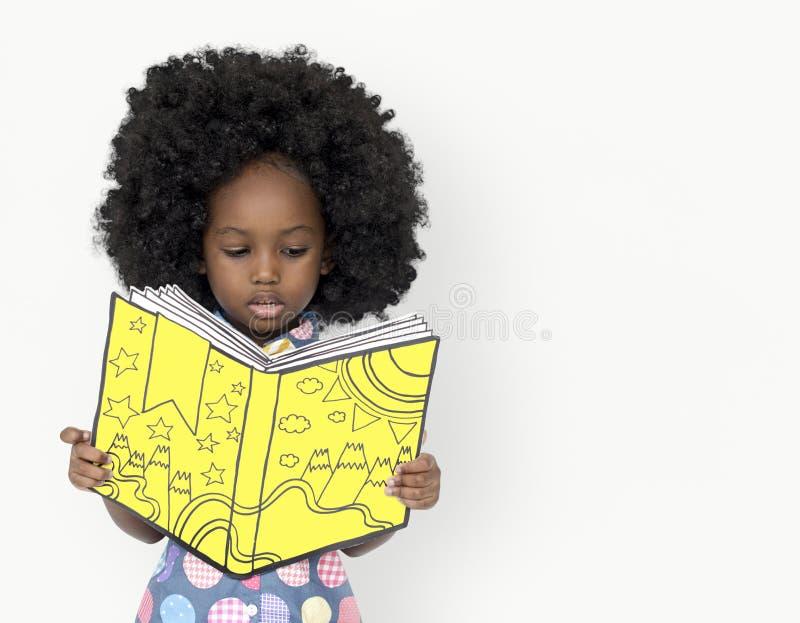 Little African Girl Reading a book stock photos
