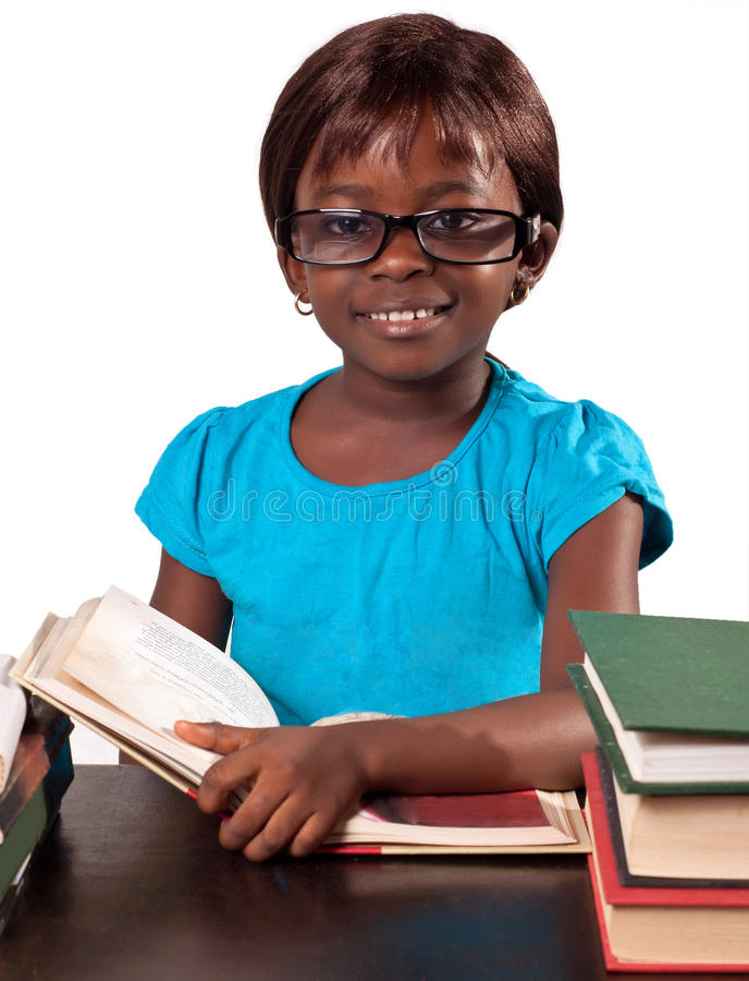 African school girl. Cute african school girl studying over white background royalty free stock images