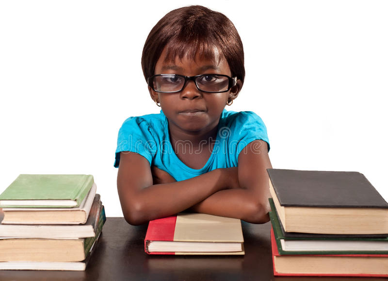 Download Little African School Girl By Stack Of Books Stock Photo - Image: 36930866