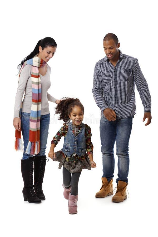 Little afro girl running parents watching stock photos