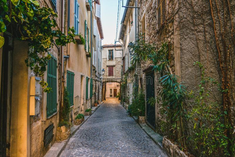 Little alley in the medieval village of Antibes in a sunny winter day. Cote d`Azur French Riviera is situated in the southern eastern part of the mediterranean royalty free stock image