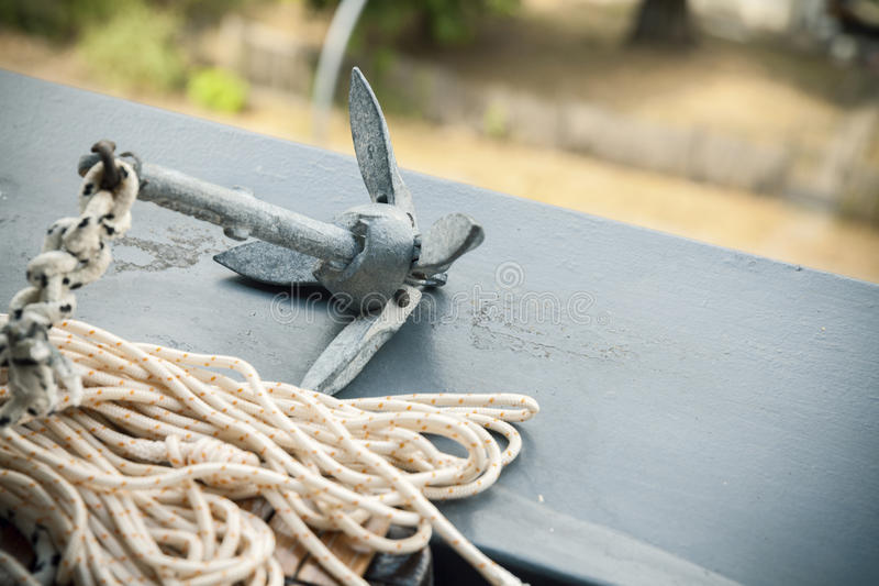 Little anchor for a boat. With a rope royalty free stock photos