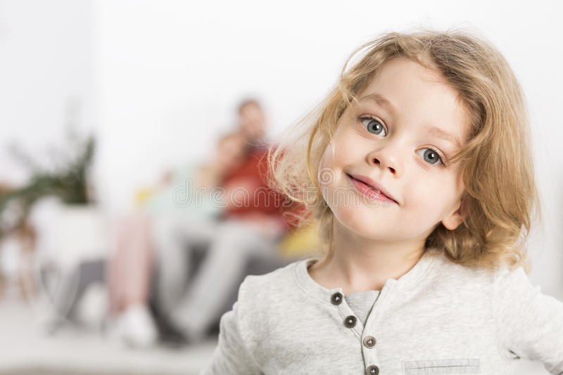Little angel living happily in a loving family stock photo