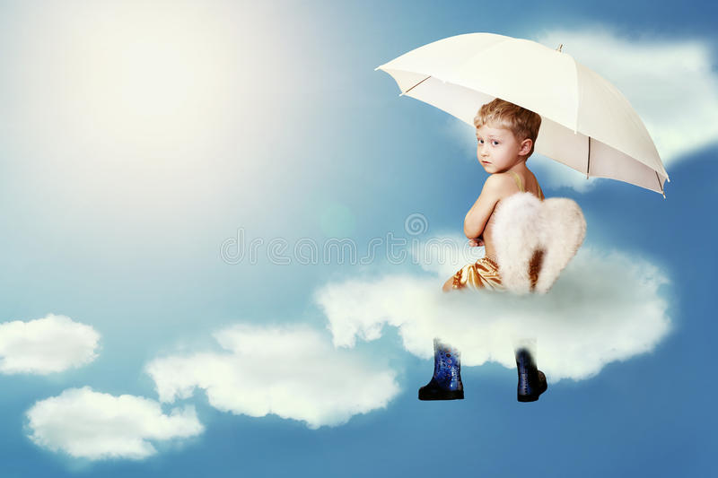 Little angel sitting on the cloud royalty free stock photos