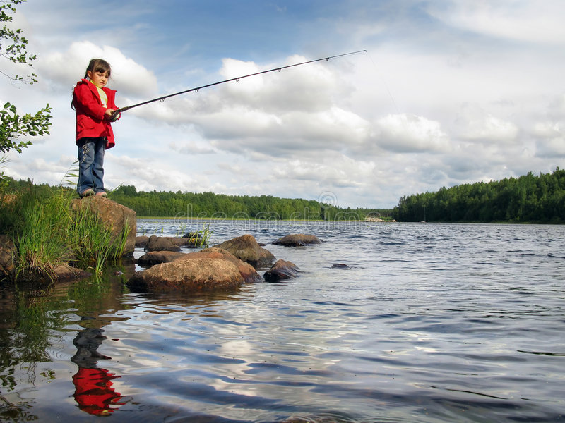 Little angler girl fishing on lake with rod stock photo for Girl fishing pole