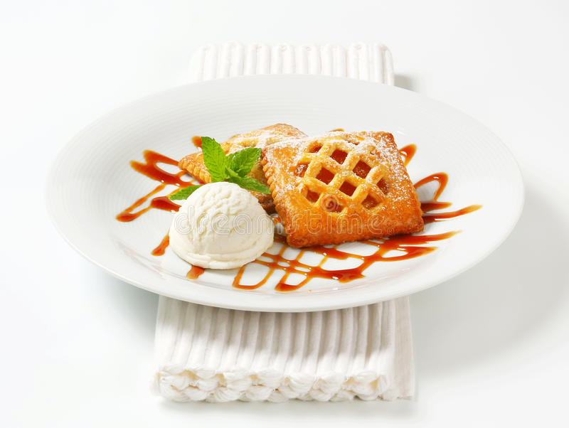Download Little Apricot Pies With Ice Cream Stock Photo - Image of place, baked: 39505716