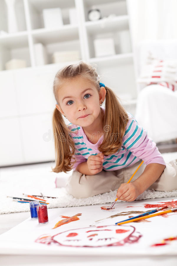 Little artist girl painting stock image