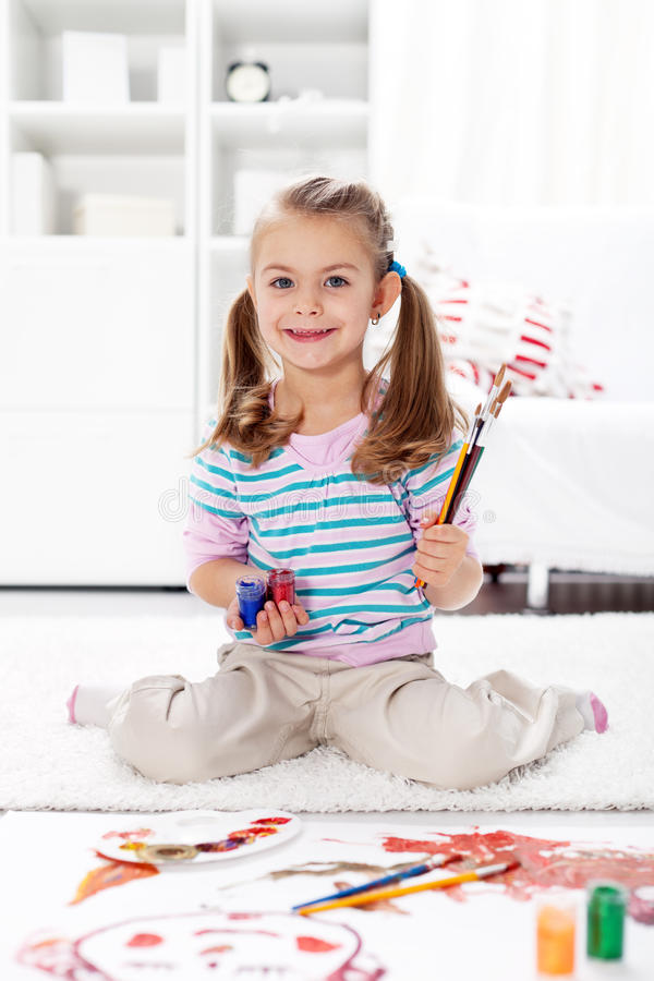 Little artist girl painting at home royalty free stock photos
