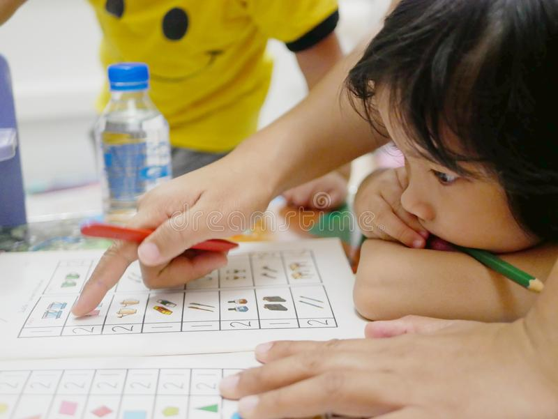 Little Asian baby girl learning to count numbers at home royalty free stock image