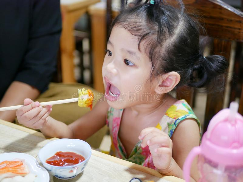 Asian baby girl tasting tomato sauce for the first time in her life royalty free stock photos
