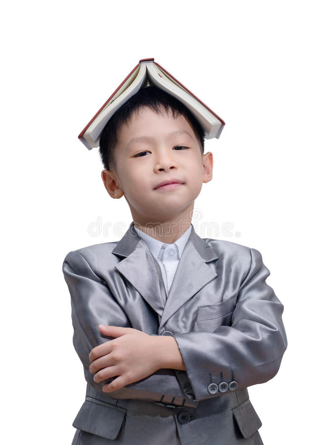 Little Asian boy in suit standing with a diary. Isolated over white background stock photography