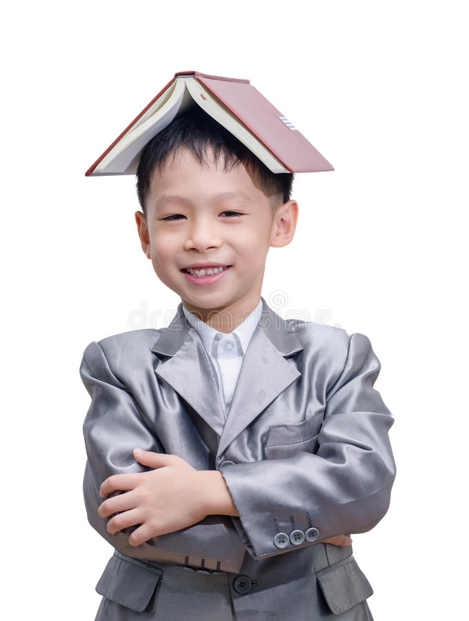 Little Asian boy in suit standing with a diary. Isolated over white background royalty free stock images