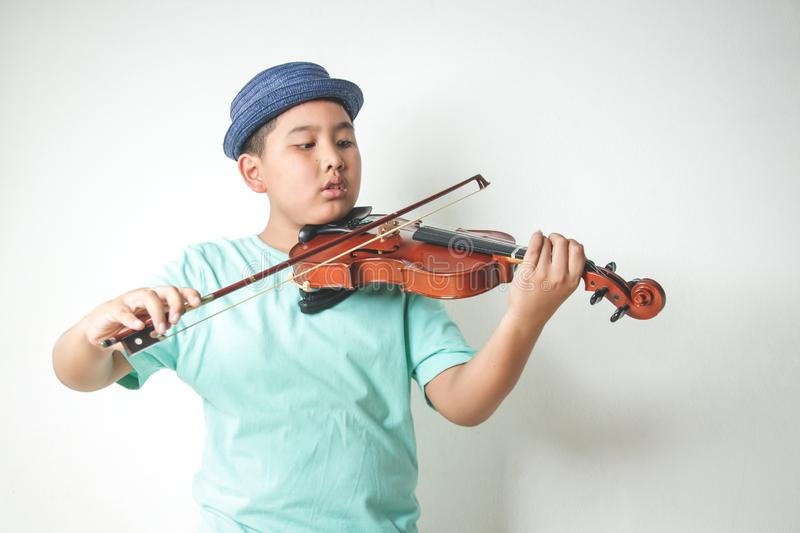 Asian boy playing violin music royalty free stock image