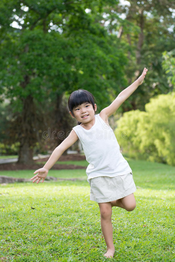 Little Asian child in the park stock photos