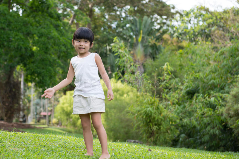 Little Asian child in the park royalty free stock images