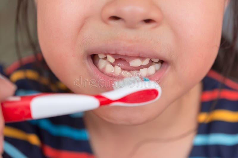 Little asian cute girl brush teeth royalty free stock photography