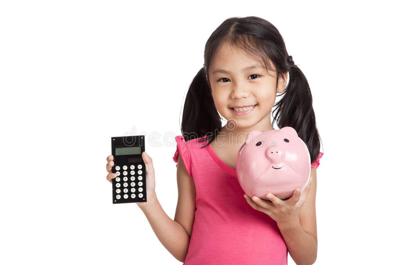 Little asian girl with a calculator and piggy bank royalty free stock photo