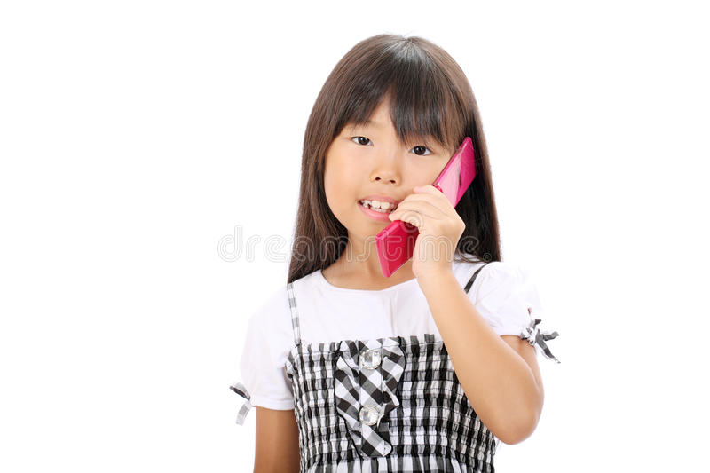 Download Little Asian Girl Calling By Phone Stock Photo - Image: 27689296