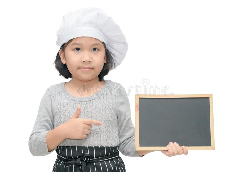 Little asian girl chef in uniform cook holding blackboard stock photography