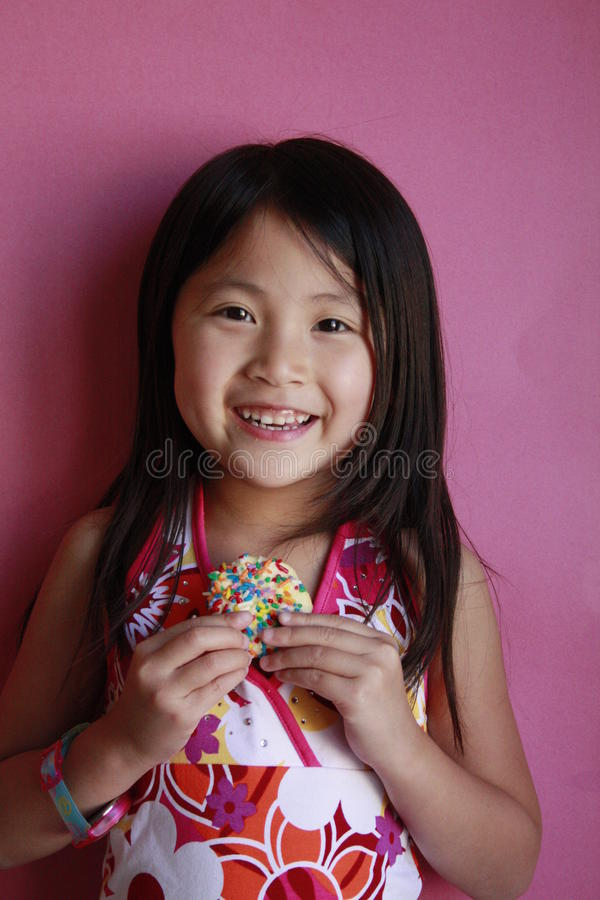 Download Little Asian Girl With Cookie Stock Image - Image: 14389489