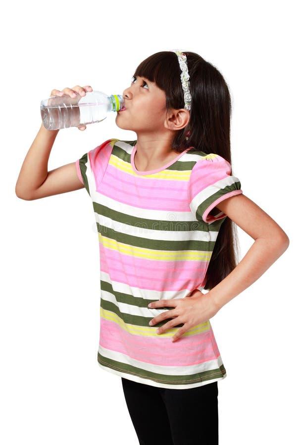Little asian girl drinking water stock photo