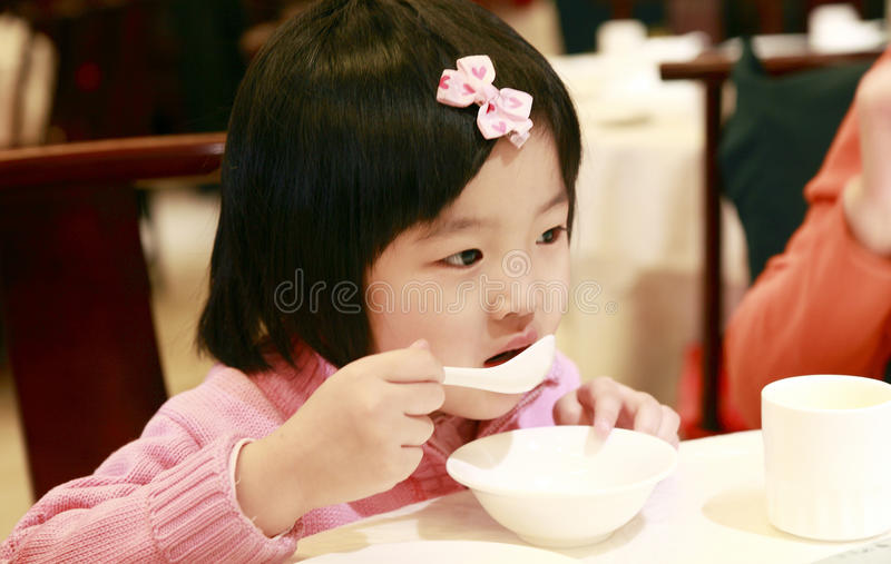 Download Little asian girl eating stock image. Image of kids, dining - 13005405