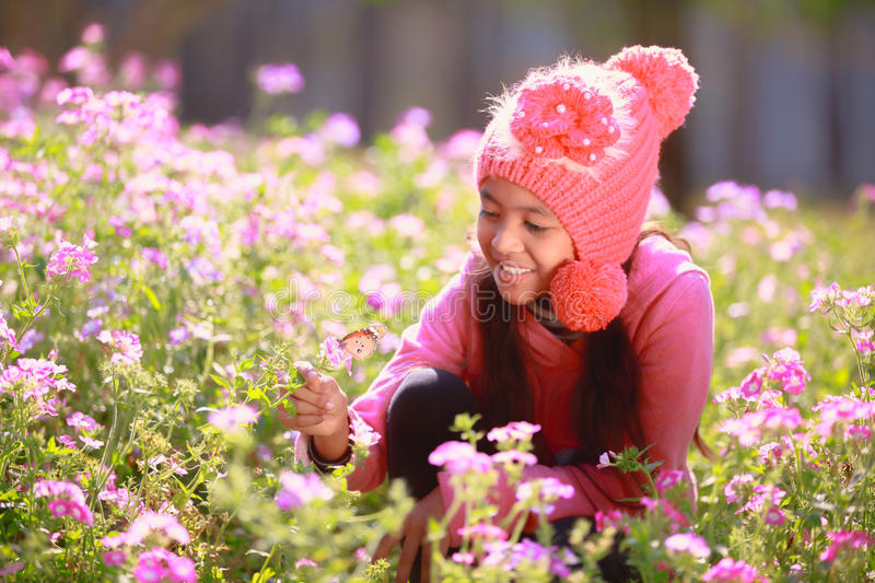 Little asian girl. With flower fields in winter, Outdoor portrait royalty free stock photos