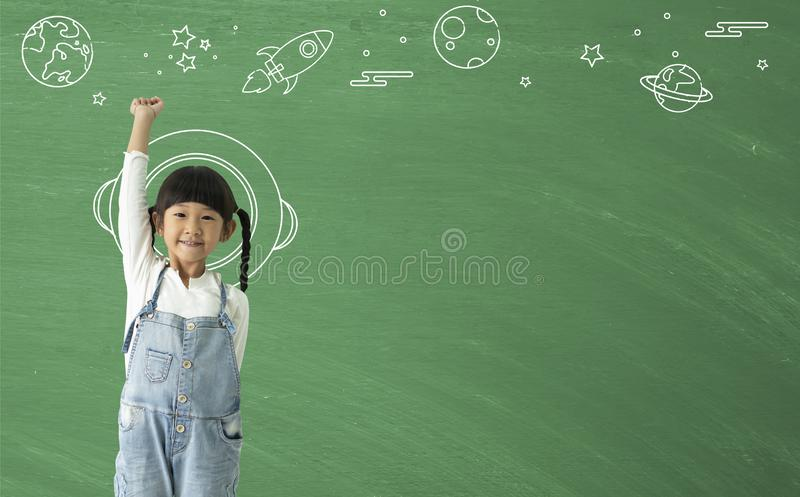 A little asian girl happy smiling  imagination with learning science technology royalty free stock photo