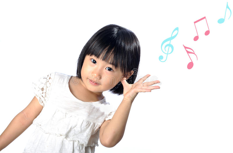 Little asian girl listening to music in the nature stock photos