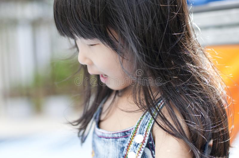 Little Asian girl in playground royalty free stock photography