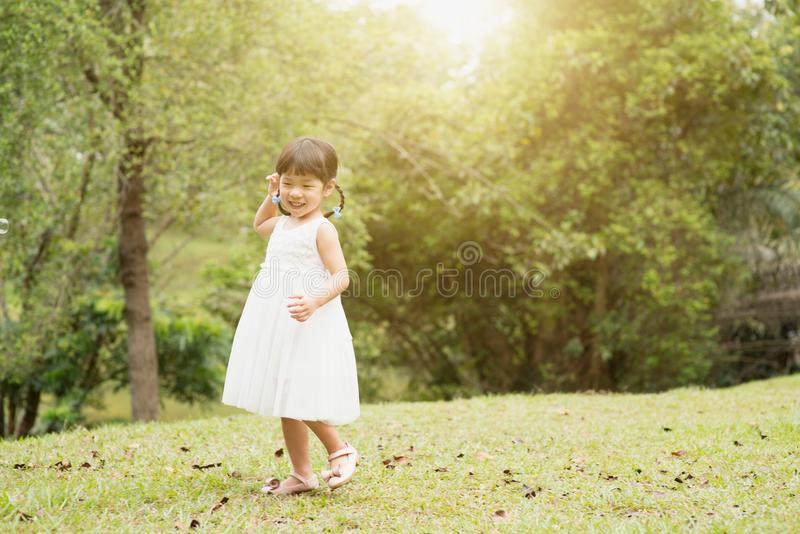 Little Asian girl playing at park stock photography