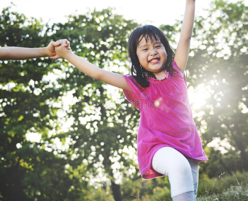 Little Asian girl playing in the park royalty free stock photography