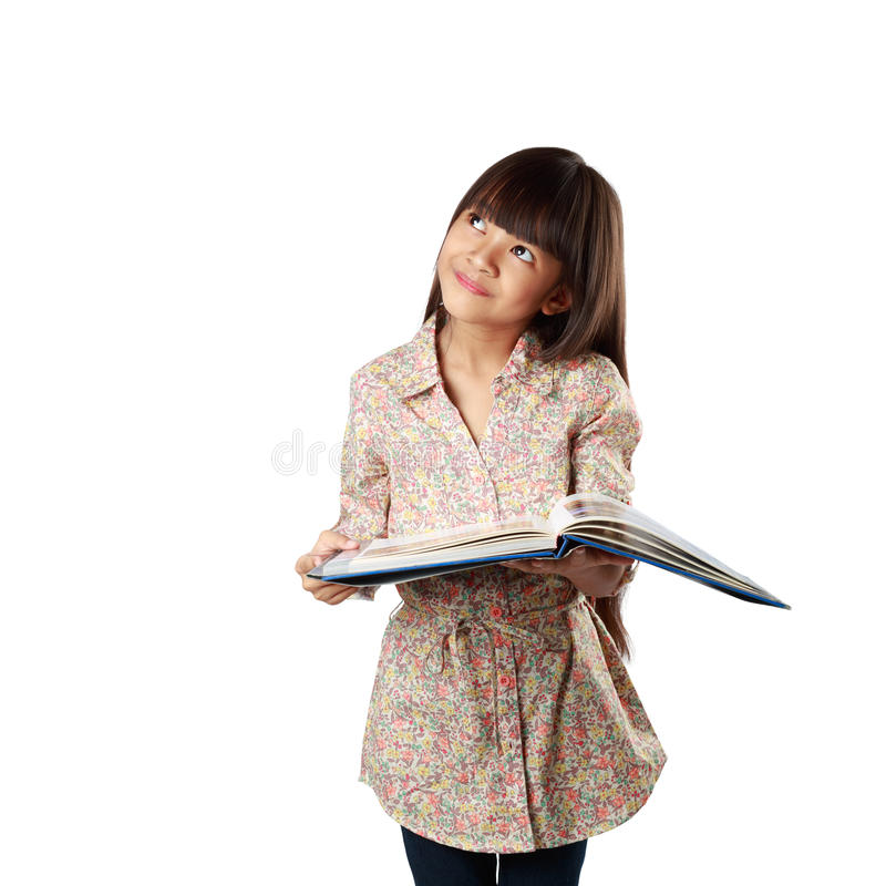 Little asian girl with textbook royalty free stock photo