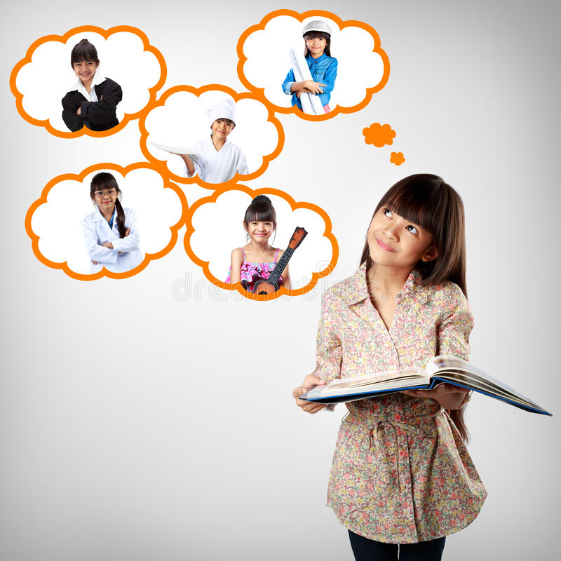Little asian girl thinking of future education. Career choice options student stock photos