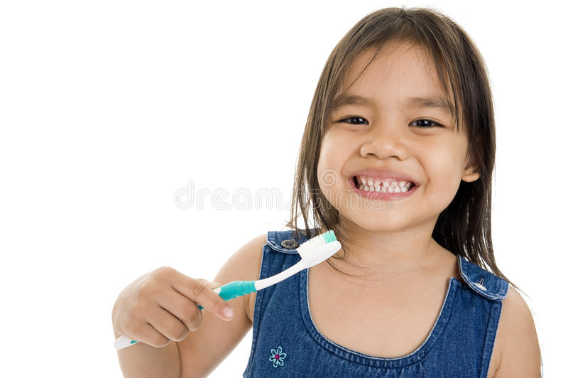 Little asian girl with toothbrush stock image